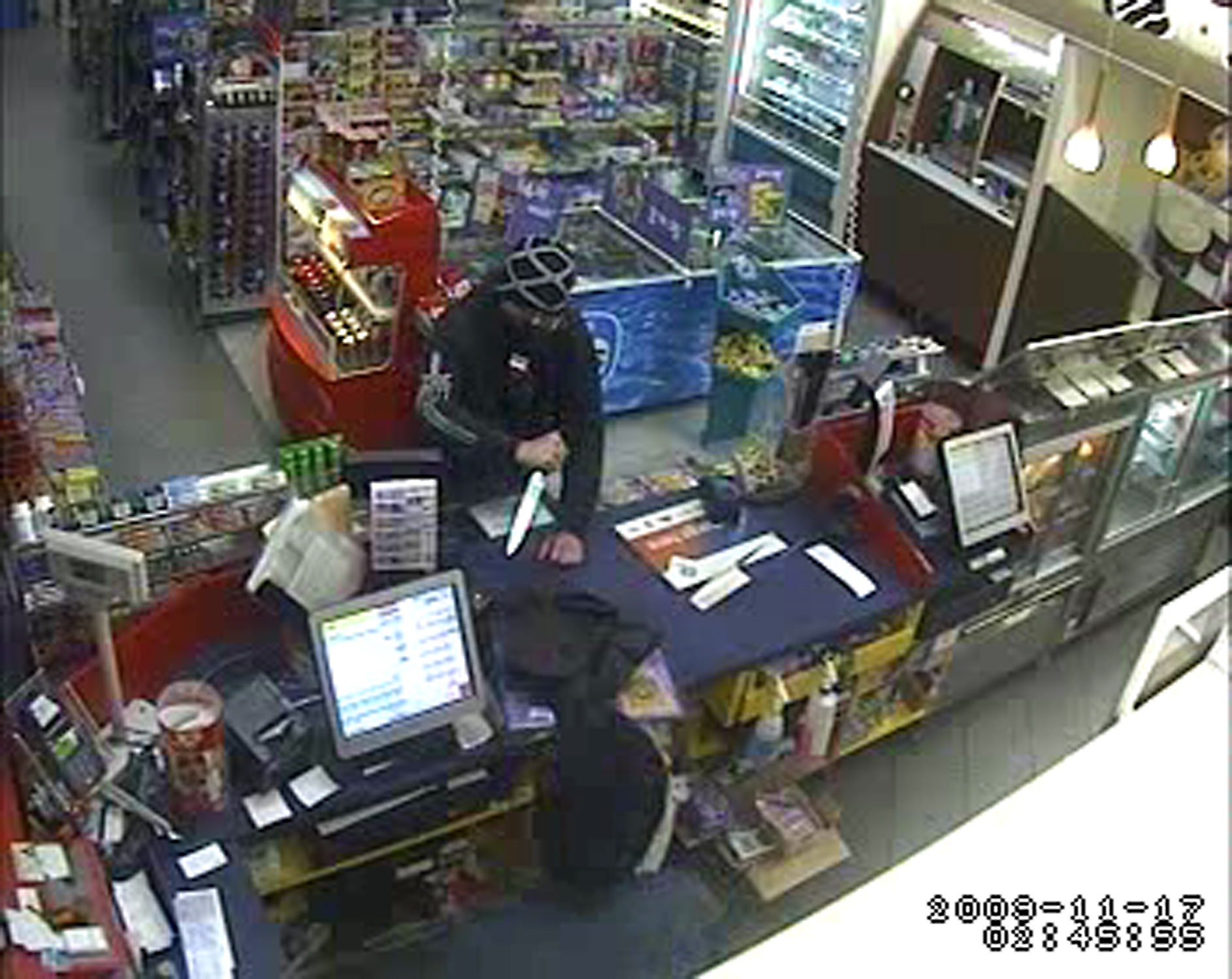 A still taken from CCTV footage of the Caltex service station aggravated robbery in Braddon (1 of 2)